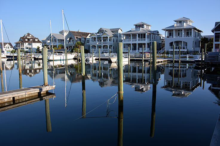 Homes line the harbor on Bald Head Island, NC
