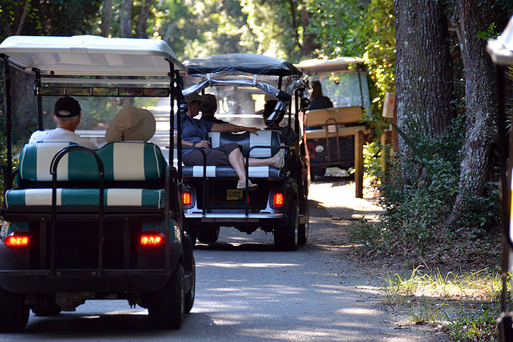Several golf carts on the streets of Bald Head Island, NC