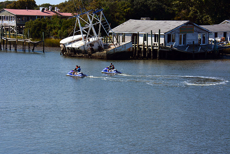 Jet Skiiers Near An Abandoned Fishing Ship In Holden Beach Nc