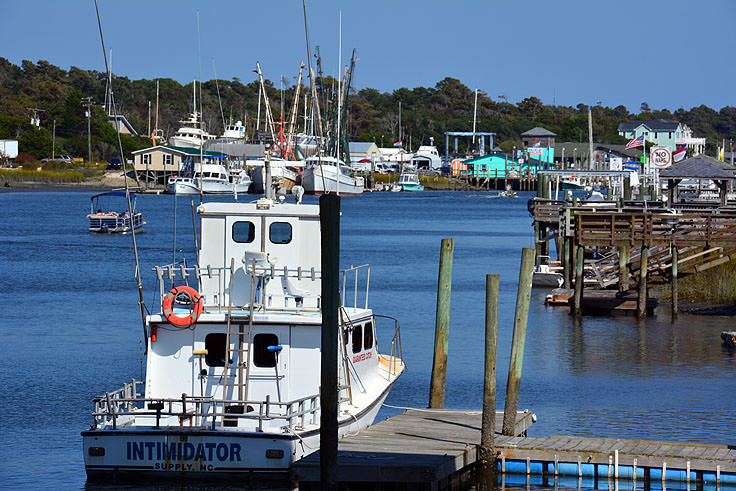 Fishing and pleasure boats line the shores near Holden Beach, NC