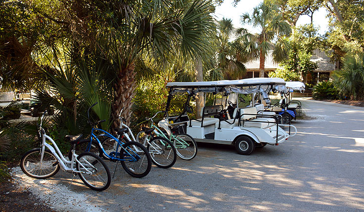 Golf cart and bike parking at Maritime Market on Bald Head Island, NC