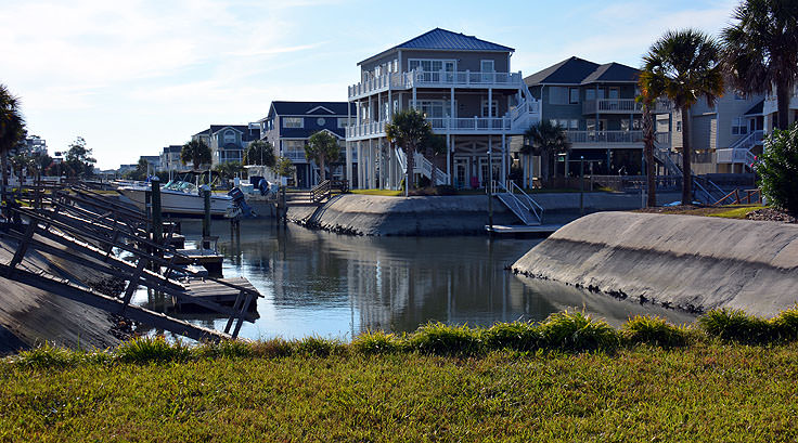 Homes line a canal in Ocean Isle Beach