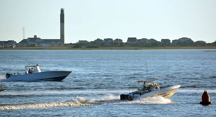 Watching boats in the Cape Fear River at Waterfront Park in Southport, NC