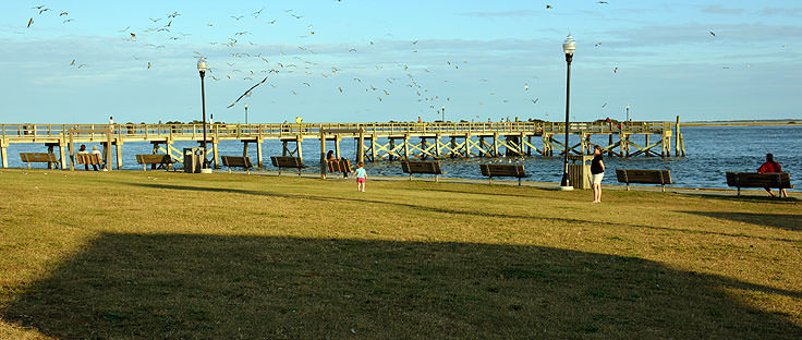 Benches and a pier at Waterfront Park in Southport, NC