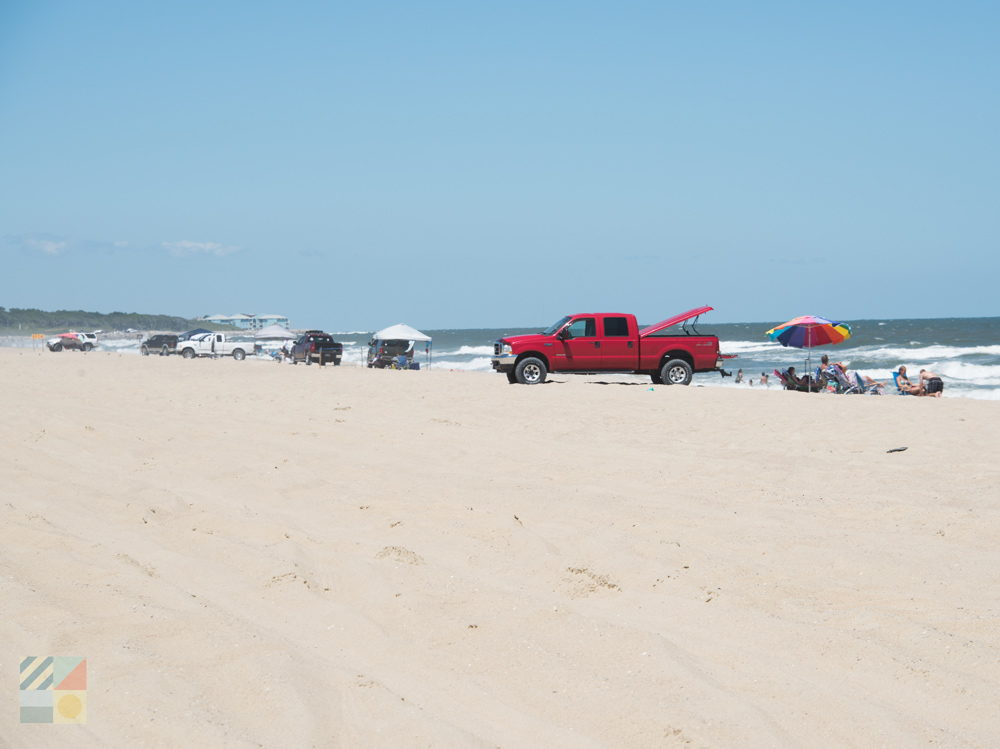4x4 vehicles parked on the beach at Freeman Park
